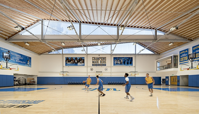 Team members playing in the solar controlled, light filled gymnasium.