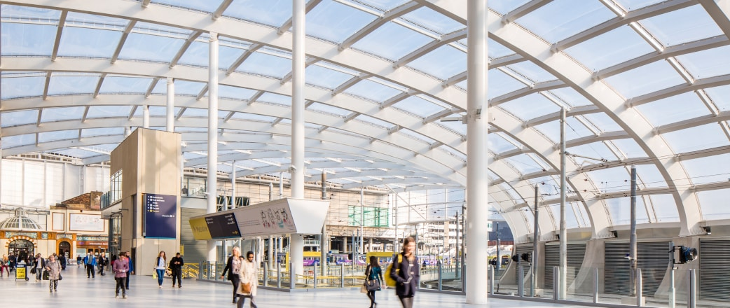 people walking under the Texlon ETFE roof at Manchester Victoria Station - a refurbishment project