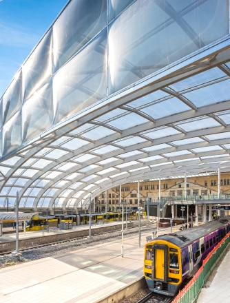Train arrives under the Texlon ETFE roof at Manchester Victoria Station