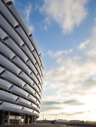 Baku Olympic Stadium's facade in daylight.