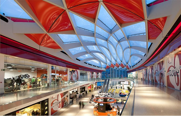 "The shopping mall ""Médiacité"" in Belgium features pigmented red foils and individual shapes."