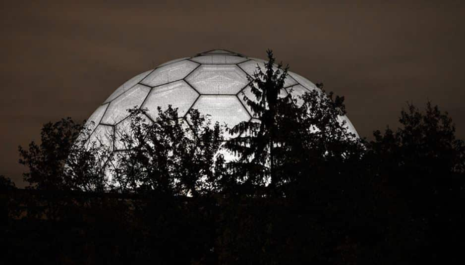 Night time view of the illuminated ETFE geodesic dome.