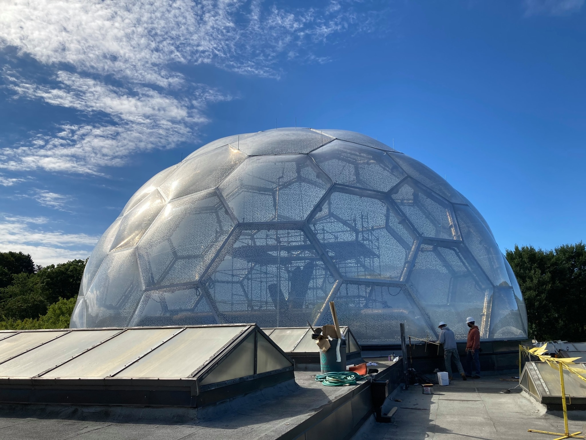 The transparent ETFE dome during cushion installation.